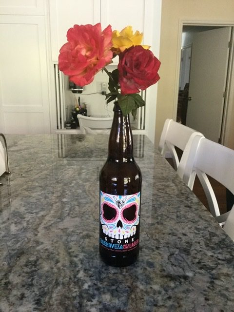 Image of beer bottle with flowers.